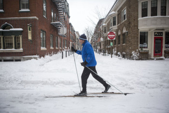 PHILADELPHIA, PENNSYLVANIA - JANUARY 23: A man skies through downtown Philadelphia as snow continues to fall on January 23, 2016 in Philadelphia, Pennsylvania. The city, which announced a snow emergency, is expected to get over 18 inches of snowfall, along with much of the Mid Atlantic States. (Photo by Jessica Kourkounis/Getty Images)